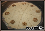 6. With a knife divide into 8 triangles and decorate with halves of nuts.