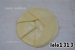 Each semicircle in the Central part I smeared softened SL.butter and sprinkled with sugar.  On the outside all parts are lubricated with beaten egg+ a little water to all parts of the outer circle was sealed.And on the last layer,the lubrication, the egg will give the product an appetizing appearance.