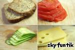 Все, как вы понимаете - очень просто...    Отрезаем пару ломтиков хлеба, несколько ломтиков помидора и огурца. Резать нужно куски побольше, чтобы при поедании бутерброд не очень активно разбегался :-D