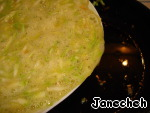 Add the fried mixture of zucchini, onion, salt and pepper, mix thoroughly and pour into hot pan with oil.