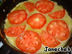 Spread on top, for example, chopped tomato, reduce the heat, cover and leave on the fire until cooked.  Can be baked in the oven or slow cooker.