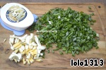 To prepare the filling, mix green onions, boiled eggs, salt, black pepper.