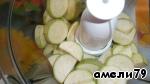 Grind zucchini in a food processor.