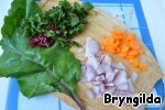 Now cut vegetables and beet tops and sauté lightly in butter, and leaves the tops do not put, and put the stalk.