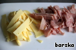 Cut into strips ham and cheese.