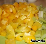 Peppers and celery were cut into nebolshimi cubes-squares,