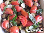 Tomato cut into slices, add to vegetables along with the garlic and Basil leaves.