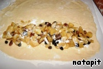 Thinly roll out portion of dough into a rectangle and build on the long edge of the half of the filling.