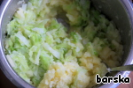 Ready cabbage to drain and squeeze. Add to potatoes and stir.