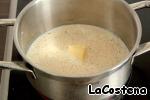 In a saucepan heat the milk, butter, nutmeg, pepper mixture and salt to taste.