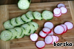 Slice cucumbers and radishes thin slices.