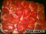 Put a layer of tomatoes and put into the oven 200g. on 15 minutes.
