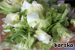 Cut into large squares half of a large head of iceberg lettuce.