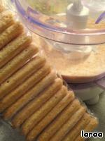 Biscuit sticks grind into crumbs.