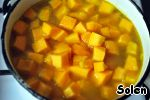 Add the boiled or canned chickpeas, chopped pumpkin. Pour in the stock. Bring to a boil, add salt and pepper to taste, cook for another 25-30 minutes (until cooked pumpkin).