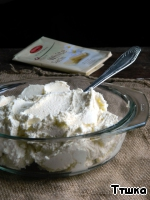Mix cottage cheese with melted chocolate and sour cream, mix, chill 30 minutes in refrigerator.