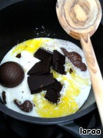 Cream bring to a boil. Add chocolate and butter. Stir until all is dissolved. To add