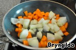 Onions and carrots cut into large cubes and lightly fry in a pan.